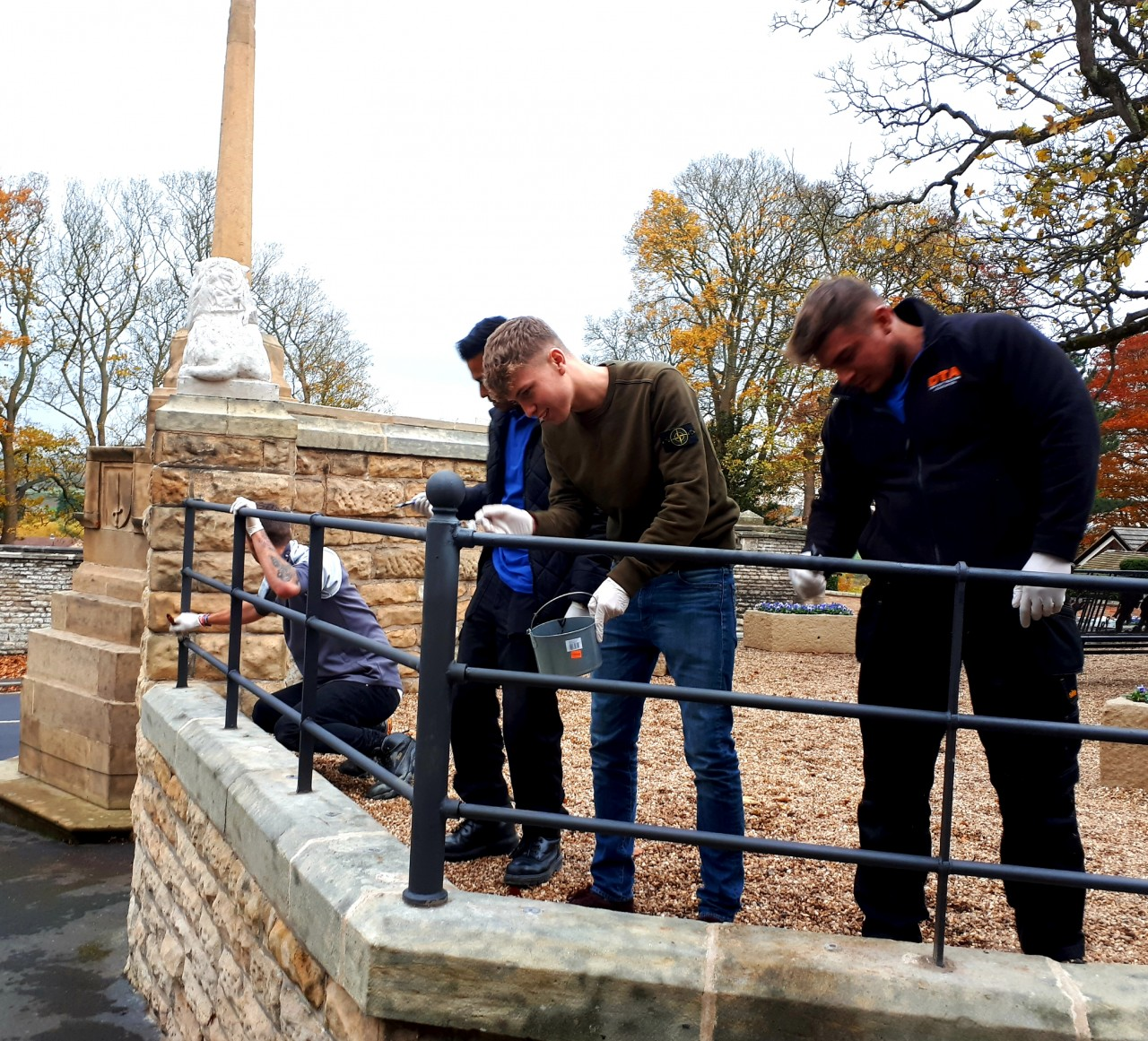 Apprentices help with installation of War Memorial Railings
